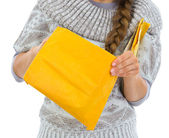 Closeup on woman opening letter — Stock Photo