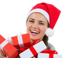 Happy woman in Santa hat with Christmas gift boxes — Stock Photo