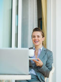 Business woman drinking coffee — Stock Photo