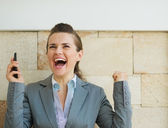 Happy business woman rejoicing success — Stock Photo