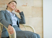 Closeup on tired business woman relaxing on chair — Stock Photo