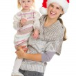 Christmas portrait of happy mother and eating cookie baby girl — Stock Photo