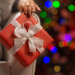 Closeup on Christmas present box in woman hand — Stock Photo #16778003