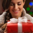 Happy young woman holding Christmas present box — Stock Photo #16778009