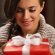 Happy young woman holding Christmas present box — Stock Photo