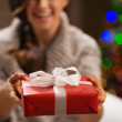 Closeup on Christmas gift box in woman hands — Stock Photo #16778023