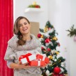 Portrait of happy woman with present boxes near Christmas tree — Foto Stock