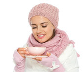 Happy young woman in knit winter clothing enjoying cup of hot te — Stock Photo