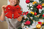 Closeup on Christmas bell decoration in woman hands — Stock Photo
