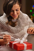 Happy young woman opening Christmas present box — Stock Photo