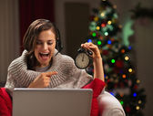 Happy young woman having video chat with family at New Year time — Stock Photo