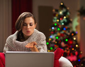 Happy young woman having Christmas video chat with lover — Stock Photo