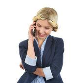 Smiling teenage girl talking mobile phone — Stock Photo
