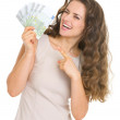 Young woman giving fun of euro banknotes — Stock Photo