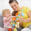 Baby playing with Easter decorations — Stock Photo