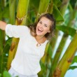 Happy young woman among tropical palms — Stock Photo #21518825