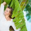 Happy young woman among tropical palms — Stock Photo #21518853