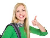 Smiling student girl showing thumbs up — Stock Photo