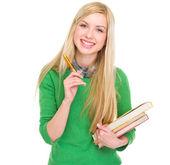 Jeune fille étudiante souriante avec livres et stylo — Photo