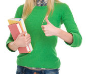 Closeup on student girl with books showing thumbs up — Stock Photo