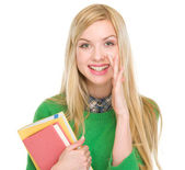 Happy teenage student girl telling good news — Stock Photo