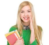 Happy teenage student girl telling good news — Stock Photo
