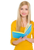 Portrait of smiling teenage student girl with book — Stock Photo