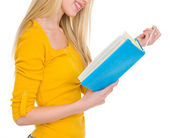 Closeup on student girl reading book — Stock Photo