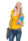 Happy student girl speaking mobile — Stock Photo