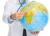 Closeup on medical doctor woman listening globe with stethoscope — 图库照片