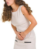 Closeup on woman having stomach pain — Stockfoto