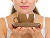 Cup of coffee in woman hands — Stock Photo