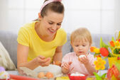 Mother and baby eating Easter eggs — Stock Photo