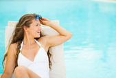 Young woman in swimsuit relaxing — Stock Photo