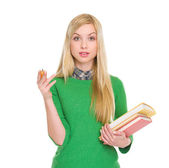 Portrait of exited student girl with books — Stock Photo
