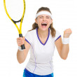 Happy tennis player rejoicing in success — Stock Photo #23413490
