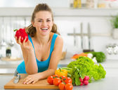 Portrait of happy young woman ready to make vegetable salad — Stock Photo