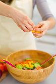 Closeup on housewife preparing vegetable salad — Stock Photo