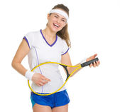 Smiling tennis player playing on racket as on guitar — Stock Photo