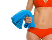 Closeup on towel in hand of young woman in swimsuit — Stock Photo