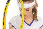 Closeup on frustrated tennis player with racket — Stock fotografie