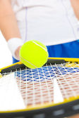 Closeup on tennis player balancing ball on racket — Stok fotoğraf