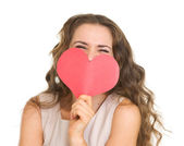 Young woman hiding valentine's day cards — Stockfoto