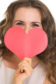 Closeup on young woman hiding valentine's day cards — Stock Photo