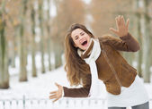 Portrait of happy young woman having fun in winter outdoors — Foto Stock