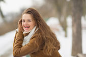 Portrait of happy young woman in winter outdoors — Stock Photo