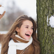 Happy young woman playing in snowball fights — Stock fotografie