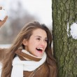 Happy young woman playing in snowball fights — 图库照片