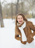 Portrait of happy young woman in winter park — Stock Photo