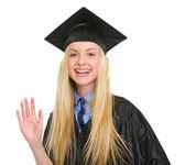 Glückliche junge frau graduation kleid grußtext — Stockfoto
